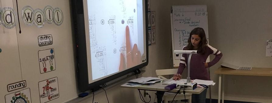 Student demonstrating math work